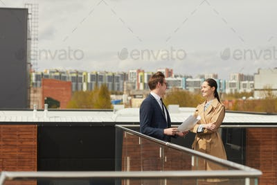 Young Business People on Roof