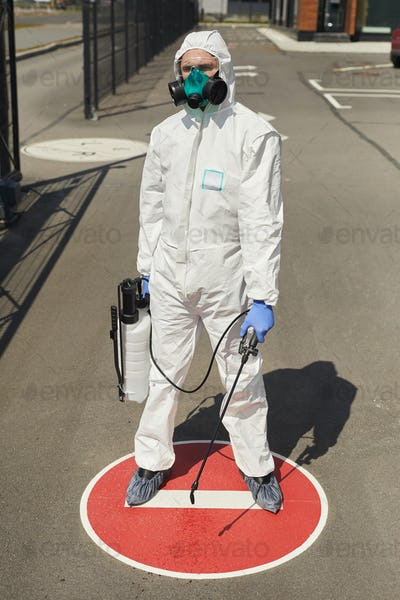 Disinfection Worker on Stop Sign