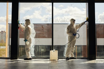 Workers doing Chemical Cleaning Indoors