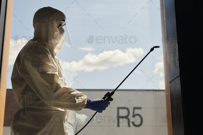 Backlit Portrait of Disinfection Worker