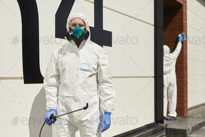 Two Workers Disinfecting Apartment Building