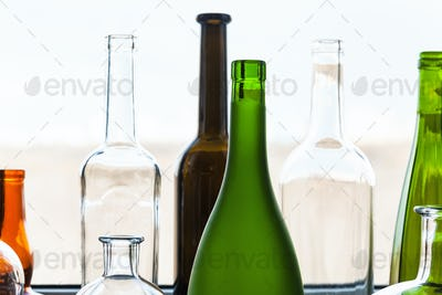 various empty bottles near window at home
