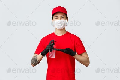 Smiling delivery man in red cap and t-shirt, wear medical mask and gloves, apply hand sanitizer to