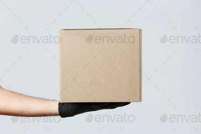 Contactless delivering, covid-19 and shopping concept. Image of courier hand in rubber gloves
