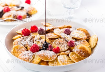 Poffertjes - small Dutch pancakes with fresh raspberries