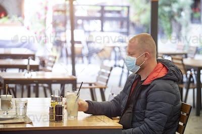 Man in restaurant during coronavirus pandemic.