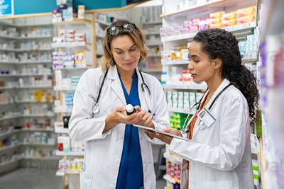 Two pharmacists working together at pharmacy