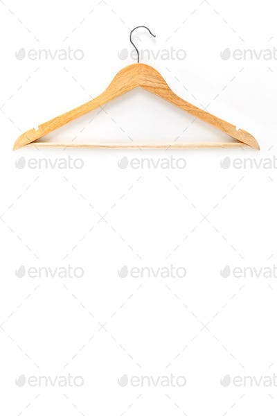 Wooden hanger isolated over white background. Mockup. Vertical image