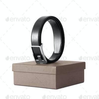 Man's black belt on box isolated on white