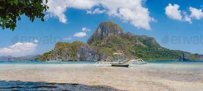 El Nido bay with trip boat and Cadlao island, Palawan, Philippines. Panoramic view