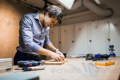 Handyman working with wood