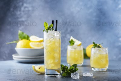 Fresh summer cocktail with lemons