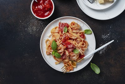 Traditional italian pasta with tomato, basil and parmesan