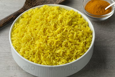 Bowl with yellow turmeric rice
