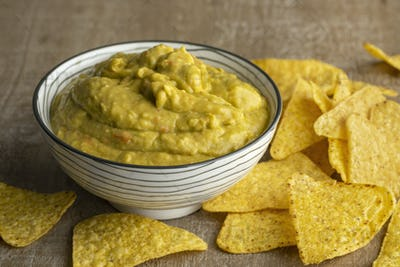 Bowl guacamole with tortilla chips and tortilla chips