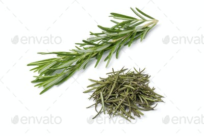 Heap of dried rosemary and fresh rosemary twig