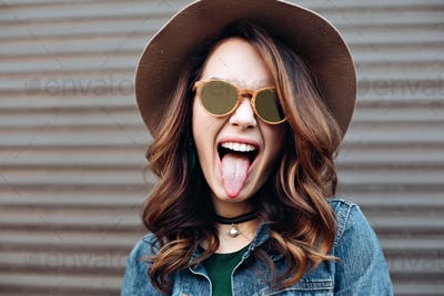 Beautiful brunette woman in sunglasses smiling at camera