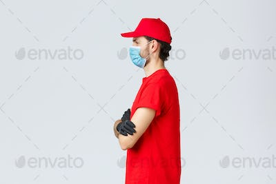 Covid-19, self-quarantine, online shopping and shipping concept. Profile f determined courier in red