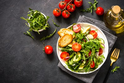Green salad from leaves and vegetables