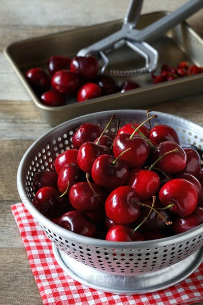removing pitts from cherries in colander
