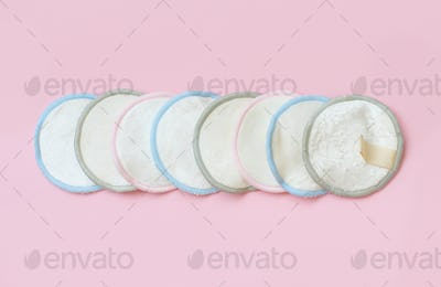 Eco friendly reusable make-up remover pads on pink background
