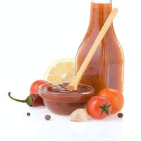 tomato sauce and ketchup on white