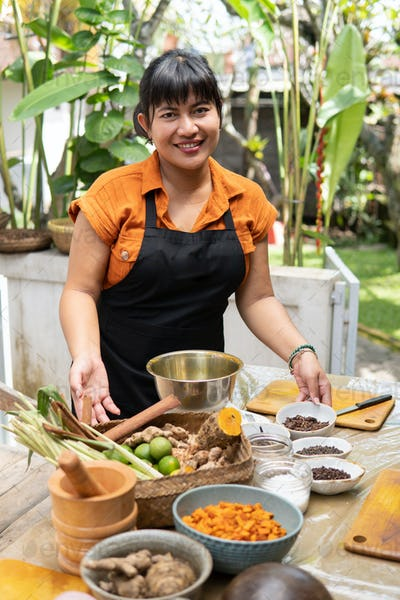 asian woman jamu maker