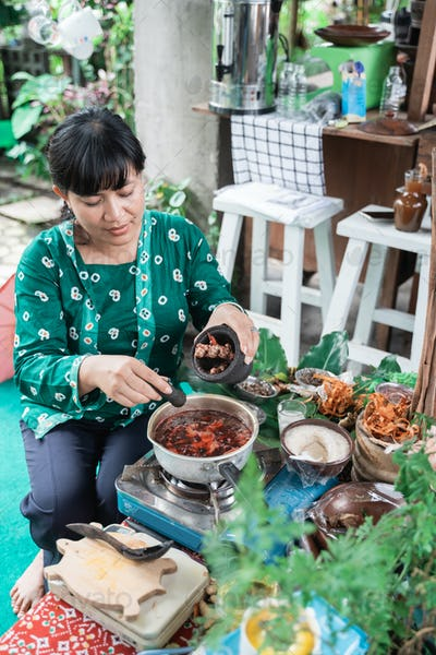 Asian women make herbal medicines make traditional Javanese herbal
