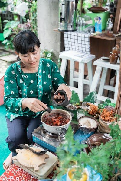 Asian women make herbal medicines make traditional Javanese herbal