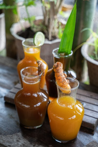 variety of traditional Javanese herbal drinks are packaged in glass bottles