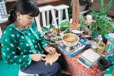 herbal medicine sellers are slicing lemongrass