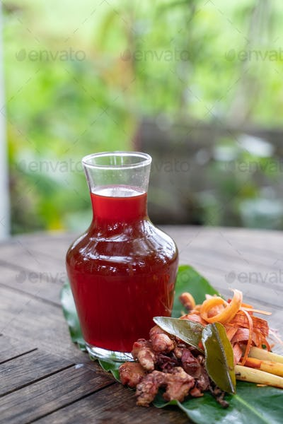 fresh red ginger drink in a glass bottle