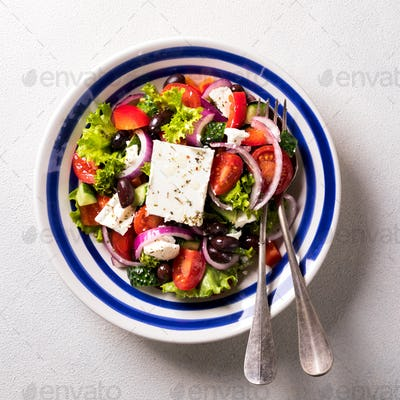 Greek salad of fresh vegetables, olives and feta. Traditional Mediterranean food.