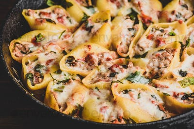 Skillet of stuffed jumbo shells pasta