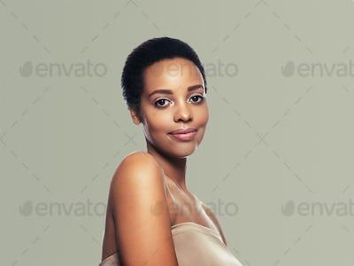 Black skin beauty woman healthy hair skin close afro american beautiful model. On gray.