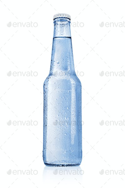 Blue glass bottle with water without label isolated on white.