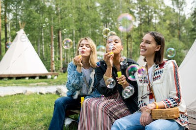 Blowing soap bubbles with friends
