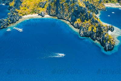 Aerial drone view of a tropical island and beach of Miniloc Island. El Nido, Palawan island