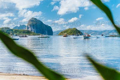 Beautiful tropical landscape. El-Nido, Philippines. Banca boats resting on tranquil early morning at