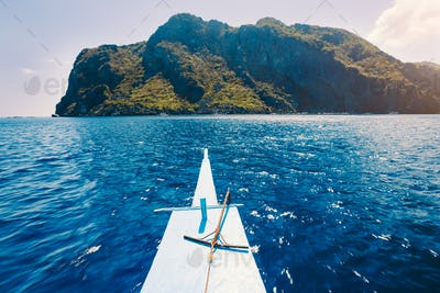 El Nido, Philippines. Front of Island hopping Tour boat hover over open blue ocean water facing