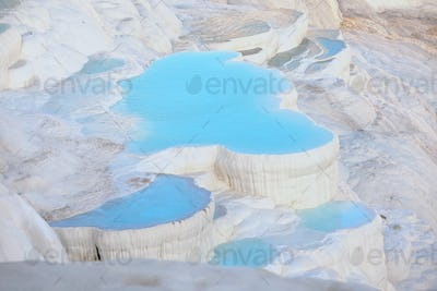 Travertine terraces with blue water in Pamukkale