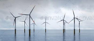 Offshore wind turbines farm on the ocean. Sustainable energy