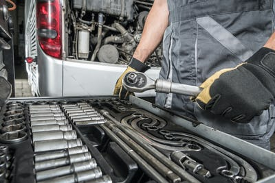 Coach Bus Service Mechanic Choosing Right Tools For the Job
