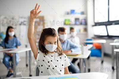 Girl with face mask back at school after covid-19 quarantine and lockdown