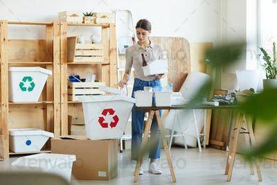 Woman doing recycling in warehouse