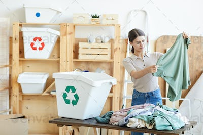 Woman recycling the clothes