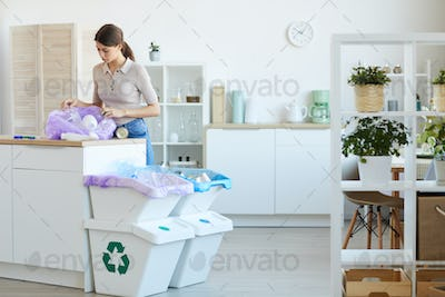 Woman working with the garbage