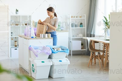Woman separating the waste