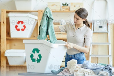 Woman recycling her wardrobe