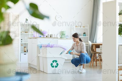 Woman sorting the paper waste